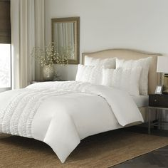 Lend a touch of feminine style to your master suite or guest room with this lovely comforter set, showcasing ruched details in white....