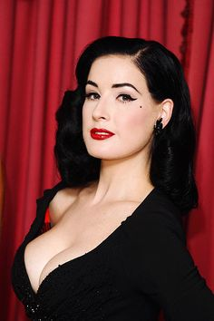 Dita Von Teese - she makes burlesque classy! A real tease indeed. She can do wonders with a stage cocktail glass haha
