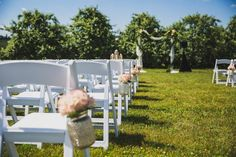 A romantic wedding ceremony we designed in the middle of an apple orchard was given a chic twist with pops of pale pink, peach and white florals.