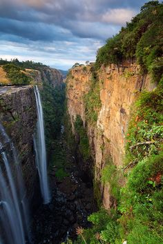 Magwa Falls, Wild Coast, South Africa Water plunges 90 meter down into the Magwa Falls gorge on a cloudy winter morning. Beautiful Places To Visit, Beautiful World, Places To See, Amazing Places, Places Around The World, Around The Worlds, Le Cap, Les Continents, Out Of Africa