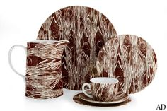 """Designer and chef Ross Sveback has applied his passion for faux-bois finishes to a new collection of ceramic tableware with knotty good looks. Shown, from left, are the 2-qt. pitcher ($100), 13""""-dia. charger ($73), bread plate ($26), cup and saucer set ($35), and salad plate ($31); other pieces are available.rosssveback.com,"""