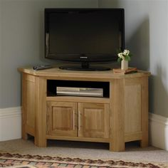 Newark Solid Oak Corner TV & DVD Cabinet  from The Cotswold Company