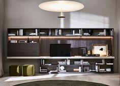 Flessibilità e funzionalità guidano il progetto 505, un sistema a spalla portante che si sviluppa in una serie di mobili componibili.