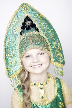 "A smiling Russian girl in national headdress ""kokoshnik""."