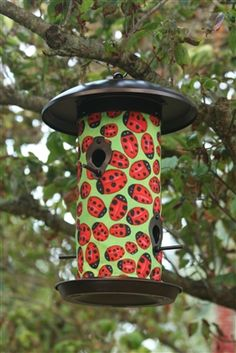 Lady Bugs Bird Feeder.  Hanging Art Bird Feeders will add a splash of color to your feathered friends feeding routine. These beautiful bird feeders' outer material is a UV and weather resistant fabric, while the inner lining is made of polypropylene and will help keep the bird seed dry ensuring a steady flow of seed. #ladybugs #birdfeeder #seedfeeder
