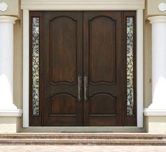 double entrance doors double wood door with wrought iron sidelites - Entrance Doors Designs