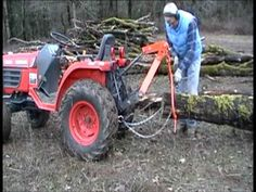 Log skidder and drop-on hitch installation - YouTube