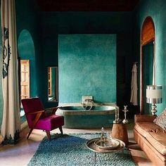 Teal has never looked so sexy and sultry as seen here. J'adore! Loving the teal walls and the pop of purple in the chair.