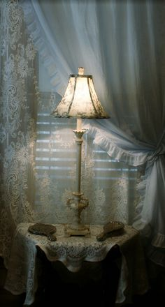 Scottish lace and Simply Shabby Chic curtains.