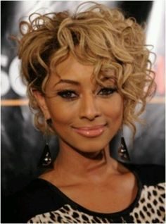 Edgy hairstlye and I like the wavy like curls and carmel blonde color too..goes with her skin tone