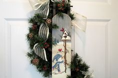 I hand painted this wood sled with lots of love and time. A cute little snowman looking up at his bird friends, on a stormy, winter day. At