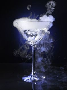 exotic acohol cocktails | Exotic drink in a martini glass with smoke coming out of it - Downl...