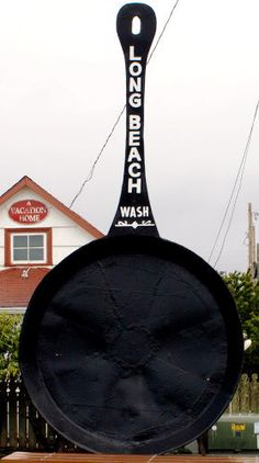 This was once the world's largest frying pan, but has since been surpassed by other giant cookware. It is 9 feet 6 inches tall. It was certainly America's first giant pan, built in 1941 in Long Beach, Washington.
