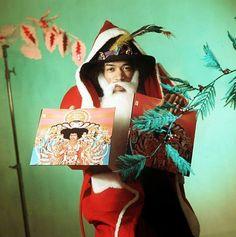 Vintage Advert Featuring Jimi Hendrix Dressed As Santa Claus