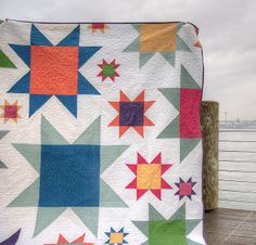 Sawtooth Star quilt.  Love the various size stars and the use of solids in pretty colours.