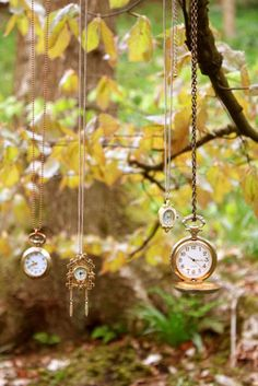 Love these fob watches....these could be hung inside a frame as part of your Alice in Wonderland props.