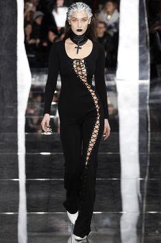 Fenty x Puma By Rihanna- Autumn / Winter 2016 AW16 - Bella Hadid wearing laced black jumpsuite