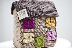 Ravelry: Knitted House pattern by Suzie Johnson-I wish this was a free pattern, I may just have to buy the book!