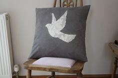 Reverse appliqué cushion handmade