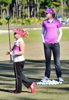 Paula Creamer gives pointers to Bella Dovhey, 7, during a clinic at the University of North Florida Golf Complex on Wednesday, February 11, 2015
