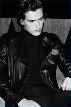 Tapping into a cool edge, Jegor Venned sports a leather jacket, turtleneck, and trousers from Massimo Dutti.
