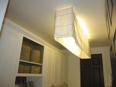 How to cover an ungly fluorescent light fixture. thedecoratingduchess.com