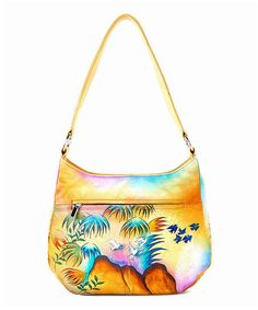 8e6801010a4 This bohemian hobo features a lasting leather construction that s hand- painted for a one-of-a-kind look.