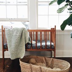 """""""minty knit made by my husband's mama hangs in our summer roommates' bassinet"""""""