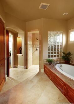Master bathroom with heated floor and seamless shower entry