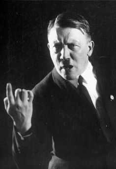 """Adolf Hitler rehearses supposedly spontaneous gestures while listening to a recording of one of his previous speeches."" - captioned by Hitler's personal photographer, Heinrich Hoffman, in 1927. The photos undermined the myth that Hitler was a natural orator, so he ordered Hoffman to destroy the negatives after viewing them. Hoffman didn't. (Source: gettyimages.ca)"