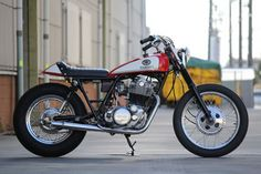 true style never goes out of fashion: a clean and classic Yamaha SR400 tracker-style custom from Japan's Motor Garage Goods.