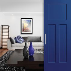 Eclectic modern living room complimented by a blue Heritage series door from Masonite Eclectic Modern, Modern Room, Modern Living, Exterior Doors, Interior And Exterior, Painting Laminate Floors, Masonite Interior Doors, Fiberglass Entry Doors, Room Doors