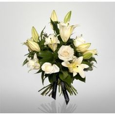 Oriental Lily Bouquet    A classic bouquet of white roses and oriental lilies
