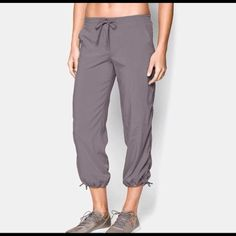 Under Armour UA Studio women capris (ab) Under Armour UA Studio Retreat women capris.  Color is steppe gray.  Size SM/P.  It has two side front pocket and two back pockets.  Adjustable hem cinch for versatile fit.  Channeled draw cord & front button closure.  Anti-microbial technology fights odor to keep your gear fresher and longer.  Very lightweight.   Has signature moisture transport system wicks sweat to keep you dry and light.  Durable woven modal for the perfect balance.  No trade.  No…