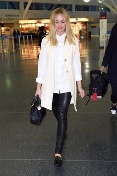 The Trend: Black & White - Margot Robbie's classic buttondown-and-skinnies formula never fails as a simple yet refined choice for the airport. A light waistcoat adds instant polish.