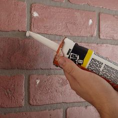 If your brick has holes or deep scratches, fill them with caulk. Flatten and smooth the caulk with a wet paper towel. Allow the caulk to dry completely before moving on to the next step. Cleaning Brick Fireplaces, Update Brick Fireplace, Brick Fireplace Remodel, Painted Brick Fireplaces, Paint Fireplace, Fireplace Design, Fireplace Makeovers, How To Clean Brick, Faux Brick Walls