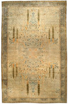 An Indian rug BB4524 - by Doris Leslie Blau.  A whimsical early 20th century Indian garden carpet, the pastel green field with a lush mirrored design of cypresse ...