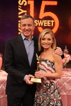 Bob Iger, Kelly Ripa. Kelly's dress is Peter Pilotto. LIVE with Kelly and Michael