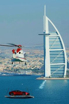 Helicopter delivering an Aston Martin on Top of Dubai's famous Burj Al Arab Hotel