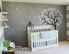 In Stock $121.00 www.wallconsilia.com This dreamy tree with white leaves and with owl sitting on the tree branch watching the night sky is a wonderful addition to your babies nursery walls. Indulge your little one's imagination with this stunning vinyl wall decal set perfect for any nursery or bedroom. We think it's a great choice for gender neutral nursery! This tree mural sticker features dreamy scene –what could a little kid love more? #Grey #Nursery #Unisex #Trees #Stars #HomeDecor #DIY
