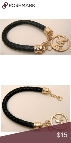 Bracelet/charm New black leather and gold , it's a bracelet works as a purse charm too! Bought this from someone here , but I don't think it's authentic! No 100% sure ,.So I'm taking offers ✅make me offer✅ Accessories