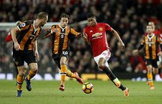 Hull City's Lazar Markovic and Manchester United's Marcus Rashford battle for the ball during the Premier League match at Old Trafford Manchester