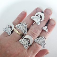 A series of moth rings by Amanda Black, of Black Rabbit Studio.