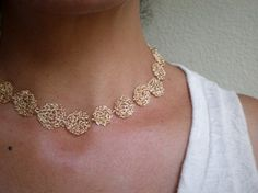 from etsy...This stunning choker is made of 14k gold filled wire crochet circles, 18 in total, each in a different size, connected together.