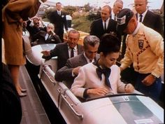 The Shah and Queen of Iran sharing a ride with Walt Disney during a visit to Disneyland, 1962.