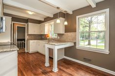Sherwin Williams Warm Stone, white kitchen, small kitchen remodel, Element Construction