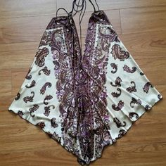Boho style Silk reversible top/dress New, boho style tunoc his has several different way to wear depending on how you tie straps. Very pretty pattern the picture doesn't show as vibrant as in person.  Purchased at a boutique in Maui . Dresses