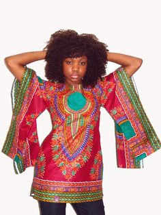 Tunique Reine Pokou bordeaux T.36    La  tunique Pokou vous habillera comme une reine. Avec ses deux manches larges,elle très élgante et sophistiqué. Parfaite pour l'été, grâce aux motifs Java qui donne une touche d'exostisme. N'attendez plus et commandez la.  Exclusivité Tribu Ebène et également disponible en T. 38, 40, 42, 44, 46, 48, 50.  You can order it only on www.tribuebene.fr S.10, 12, 14, 16, 18, 20, 22 are available.