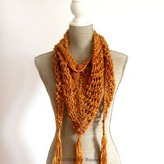 """Pumpkin Boho Shawl by NOTON by Raquel Shop The color of autumn is the pumpkin orange and with this airy shawl you will feel the autumn, still with some warm touches of summer memories.Wear it over your shoulders with a cotton shirt, or around your neck with a denim jacket, and you will dazzle!FEATURES:- Fall knit shawl with tassels- Yarn (100 cotton)- Color: Orange (pumpkin)- Fits: WOMEN SIZE- Sizes: 67,72""""/172cm (Width) x 17,32""""/44cm (Height, in the middle)"""
