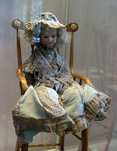 During the visit of Romanov's family to Paris in 1896, French president presented to princess Olga a fabulous doll with full trousseau: Including dresses, lingerie, hats, shoes and even dresser set .